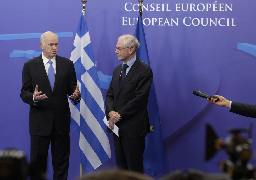 Greek Prime Minister George Papandreou (left) and European Council President Herman Van Rompuy address the media at the European Council building in Brussels on Monday, June 20, 2011. (AP Photo/Yves Logghe)