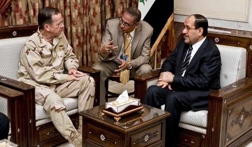 In this photo from April 21, 2011, Navy Adm. Mike Mullen (left), chairman of the Joint Chiefs of Staff, meets with Iraqi Prime Minister Nouri al-Maliki (right) in Baghdad, Iraq. At center is a translator. (Associated Press/U.S. Department of Defense)