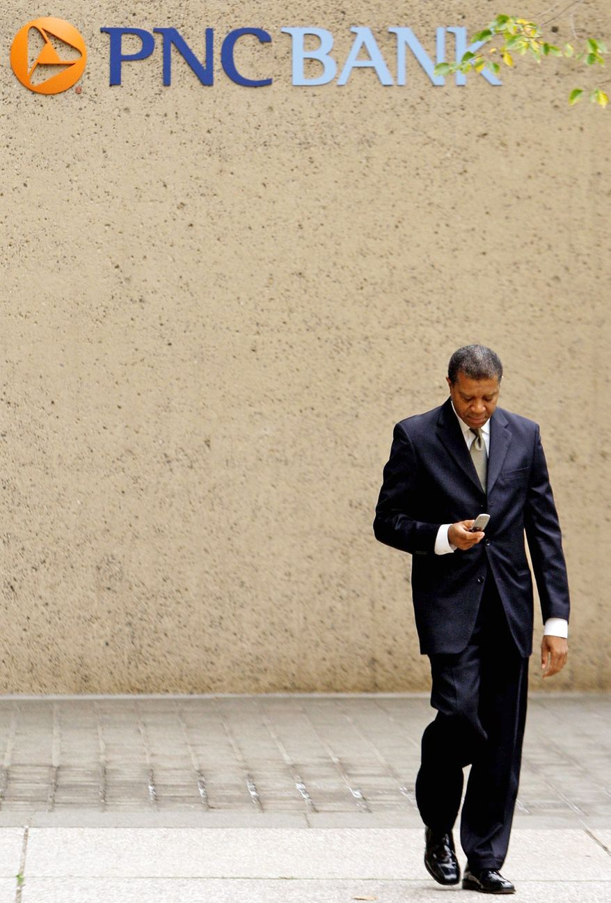 ** FILE ** A man walks leaves a PNC Bank branch in Baltimore in October 2008. (AP Photo/Rob Carr, File)