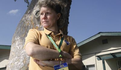 **FILE** In this photo from March 17, 2011, Christine Kwapnoski is seen at her home in Bay Point, Calif. The Supreme Court has ruled against Kwapnoski and four other plaintiffs in a massive sex discrimination lawsuit against Wal-Mart on behalf of women who work there. (Associated Press)