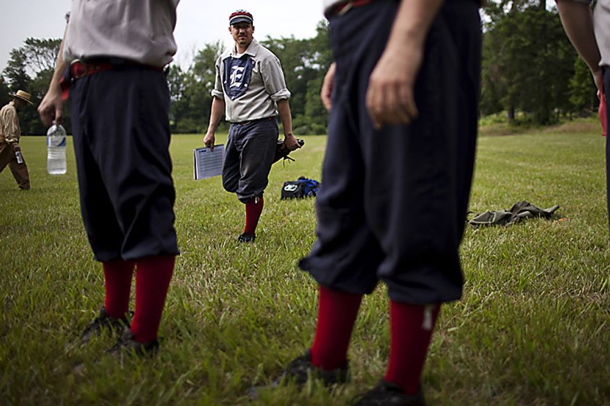 """Lee """"brew"""" Donelson of the Elkton Eclipse, center, stretches out before the games started at the Loudoun Preservation Society's 19th Century Baseball Day at the Oatlands, in Leesburg, Va., Sunday, June 12, 2011. All the players were their baseball pants baggy and rolled up showing their socks, like players did in the 1860s. (Drew Angerer/The Washington Times)"""