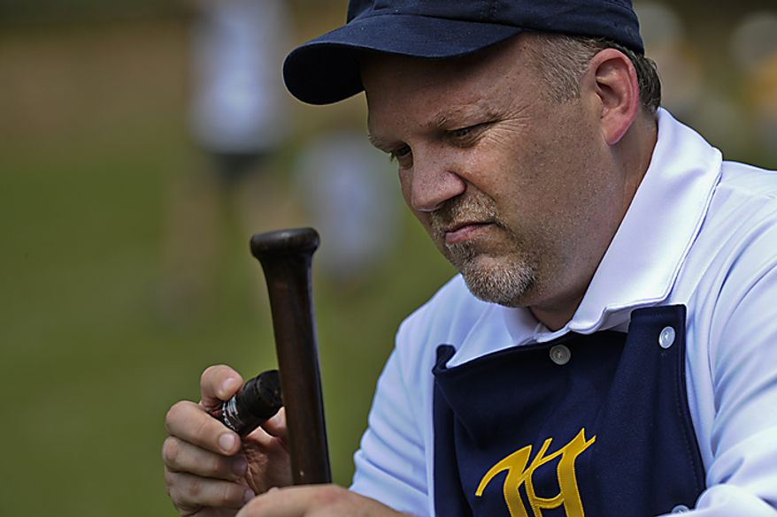 "Potomac Nine's Dave ""Hustler"" Norkus, of Crofton, Md. who has been playing in the Mid Atlantic Vintage Baseball League for two years, applies some adhesive ""grip stick"" to his bat during a game during the Loudoun Preservation Society's 19th Century Baseball Day at the Oatlands, in Leesburg, Va., Sunday, June 12, 2011. (Drew Angerer/The Washington Times)"