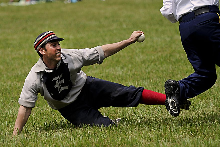 "Tim ""Ones"" Bower tries to tag out a runner during the Loudoun Preservation Society's 19th Century Baseball Day at the Oatlands, in Leesburg, Va., Sunday, June 12, 2011. (Drew Angerer/The Washington Times)"