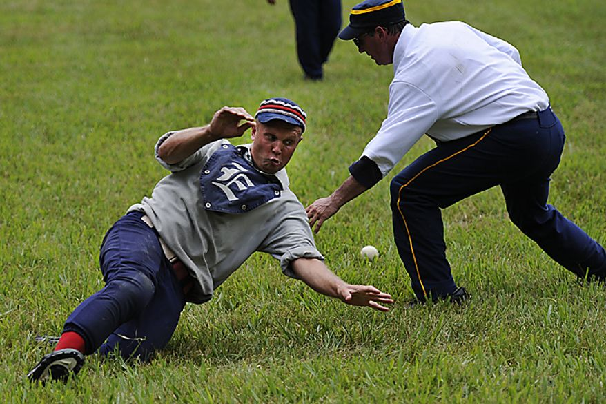 "Elkton Eclipse centerfielder Erik ""Dubs"" Meyers, of Chesapeake, Md.,  slides into home plate as he avoids a tag from Potomac Nine catcher Jeff ""Piper"" Hornberger, of Crofton, Md., during the Loudoun Preservation Society's 19th Century Baseball Day at the Oatlands, in Leesburg, Va., Sunday, June 12, 2011. (Drew Angerer/The Washington Times)"