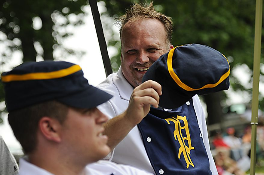 """Potomac Nine's Dave """"Hustler"""" Norkus, of Crofton, Md. who has been playing in the Mid Atlantic Vintage Baseball League for two years, smiles and jokes with Erik """"Cannon"""" Kristensen, left, during a game during the Loudoun Preservation Society's 19th Century Baseball Day at the Oatlands, in Leesburg, Va., Sunday, June 12, 2011. While the teams do play to win, most of the day is fairly laid back and enjoyable for the players. (Drew Angerer/The Washington Times)"""