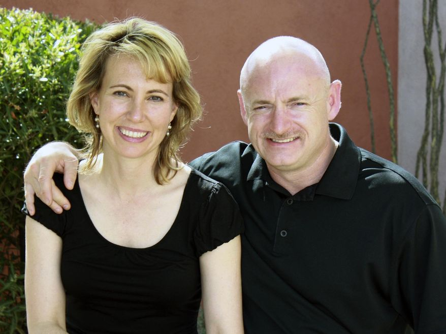 **FILE** In this undated photo, Rep. Gabrielle Giffords (left), Arizona Democrat, is shown with her husband, NASA astronaut Mark Kelly. (Associated Press/Office of Rep. Gabrielle Giffords)