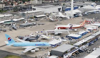 A Korean Air Airbus A380 (bottom left) is on display with other aircraft at the 49th Paris Air Show at Le Bourget Airport outside Paris on Monday, June 20, 2011. (AP Photo/Francois Mori)