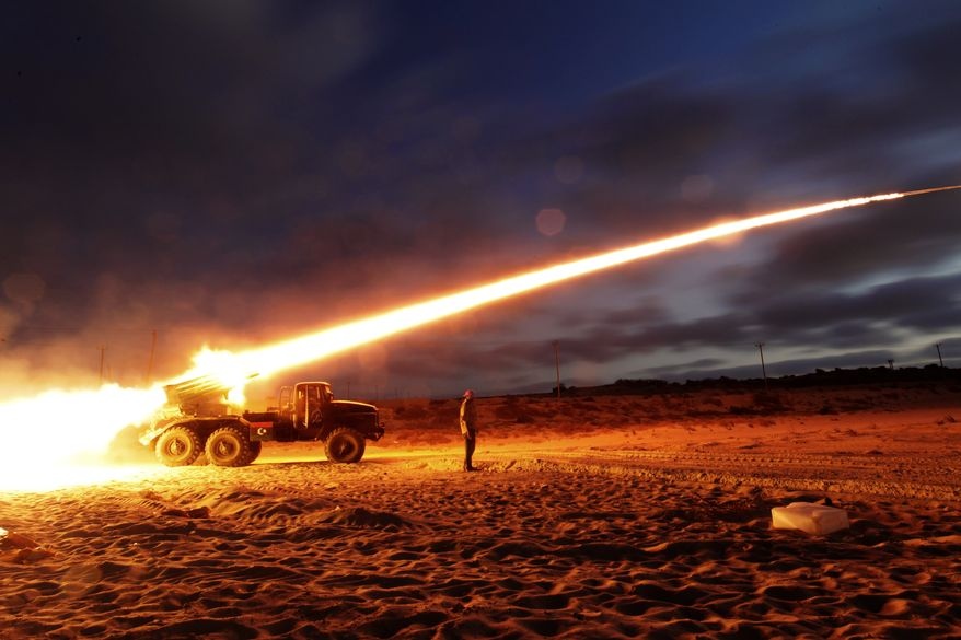 Libyan rebels fighting Col. Moammar Gadhafi's forces launch a Grad rocket at the front line west of Misrata, Libya, on Monday, June 20, 2011.  (AP Photo/Hassan Ammar)
