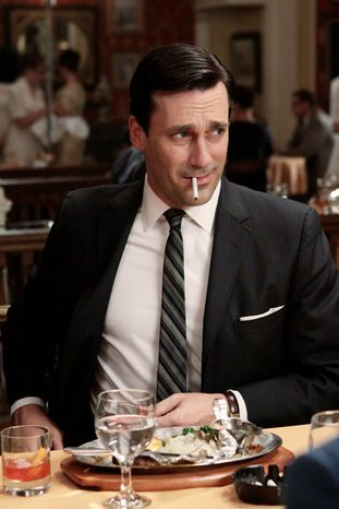 """ASSOCIATED PRESS PHOTOGRAPHS Actor Jon Hamm signed a new deal with """"Mad Men"""" studio Lionsgate Television Group that will keep him playing 1960s advertising executive Don Draper for three more years.  By the contract's final year, he'll earn more than $250,000 an episode."""
