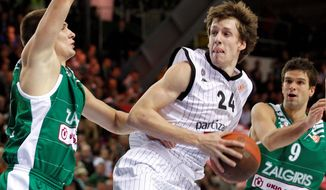 FILE - This Oct. 21, 2010, file photo shows Paulius Jankunas, left, and Mantas Kalnietis, right, of Lithuania's BC Zalgiris, guarding Jan Vesely of Serbia's BC Partizan, during a Euroleague match in Kaunas, Lithuania. Vesely is a top prospect in the 2011 NBA draft. (AP Photo/Mindaugas Kulbis) ** LITHUANIA OUT **