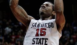 FILE - This Feb. 16, 2011, file photo shows San Diego State's Kawhi Leonard dunking against New Mexico during the first half of an NCAA college basketball game, in San Diego. Leonard is a top prospect in the 2011 NBA Draft. (AP Photo/Gregory Bull, File)