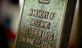 Relatives and friends of nine people killed in the June 22, 2009, Metrorail Red Line crash attended a memorial ceremony Wednesday at the Fort Totten Station. A plaque placed at the station commemorates those who died. (Rod Lamkey Jr./The Washington Times)