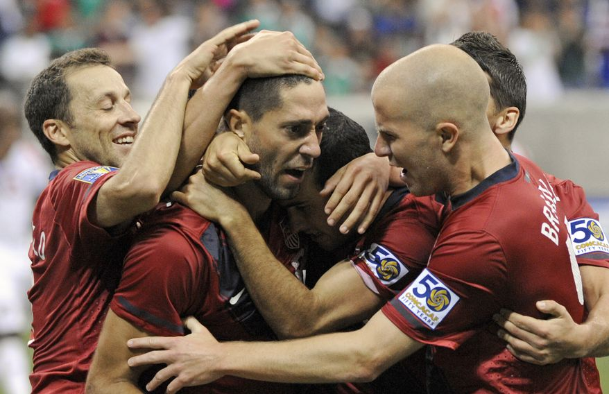 U.S. midfielder Clint Dempsey (center) is congratulated by teammates after scoring the game's only goal in a 1-0 win over Panama in the Gold Cup semifinals on Wednesday night. The U.S. will play either Mexico or Honduras for the title. (AP Photo/Dave Einsel)