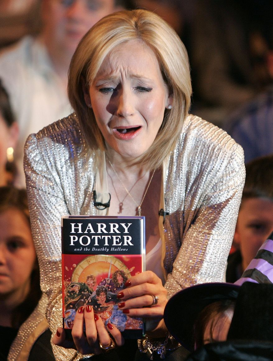 "** FILE ** In this Friday, July 20, 2007, file picture British author J.K. Rowling discusses her Harry Potter book titled ""Harry Potter and the Deathly Hallows"" at the Natural History Museum in London. (AP Photo/Kirsty Wigglesworth)"