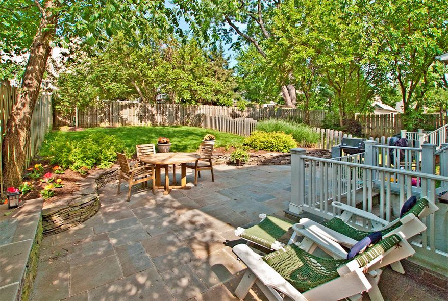 The fenced backyard of the home at 728 N. Barton St. in Arlington has a flagstone patio and space for gardening.