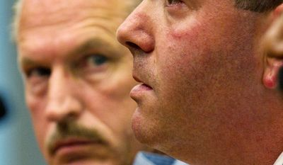 D.C. police Officer Stanley Radzilowski (left) looks on as Lt. Stuart Emerman testifies on police escorts of celebrities before a D.C. Council committee on Thursday. Lt. Emerman authorized the controversial escorting of Charlie Sheen in April. (Drew Angerer/The Washington Times)