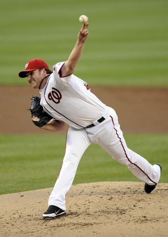 Washington Nationals starting pitcher John Lannan threw 5 2/3 innings and allowed one run against the Seattle Mariners on Wednesday night in the Nats' 2-1 win. (AP Photo/Nick Wass)