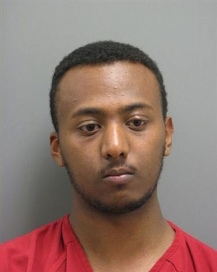 ** FILE ** This undated file photo released by the Leesburg, (Va.) Police Department shows Yonathan Melaku, 22, of Alexandria, Va., after his May 2011 arrest in Loudoun County, Va., charged with four counts of grand larceny. (AP Photo/Leesburg Police Department, File)
