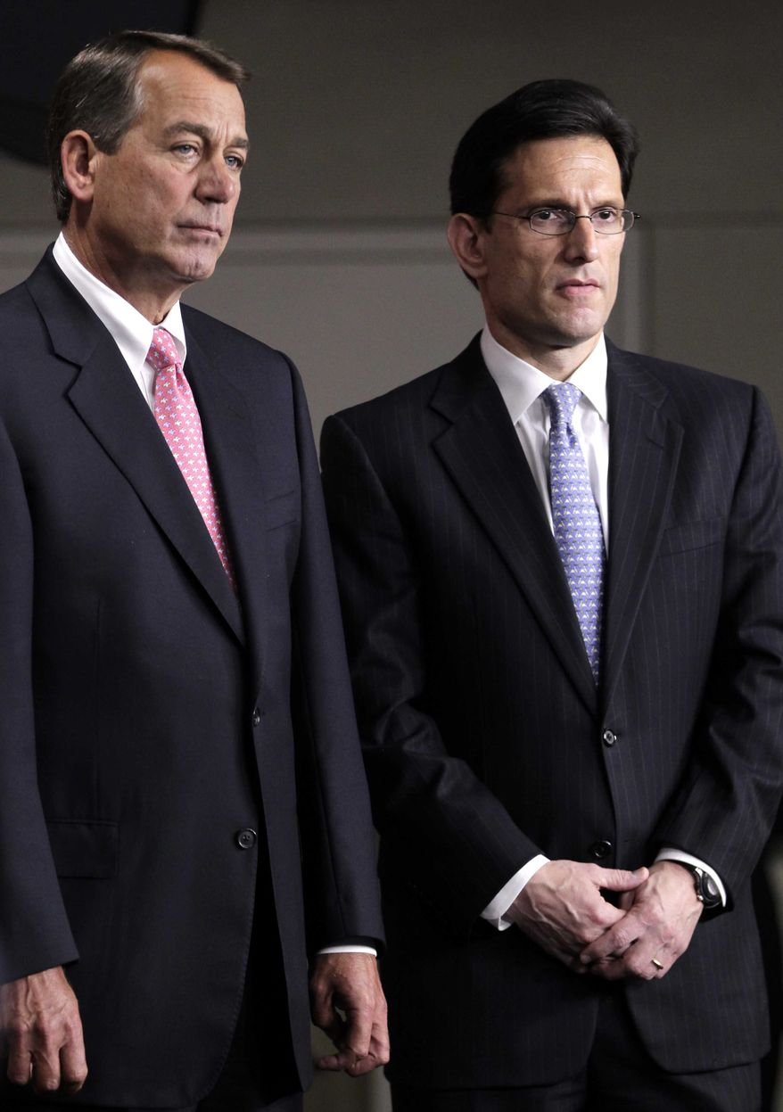 ** FILE ** In this file photo of Thursday, June 16, 2011, House Majority Leader Eric Cantor of Virginia, right, stands with House Speaker John Boehner of Ohio on Capitol Hill in Washington. (AP Photo/J. Scott Applewhite, File)