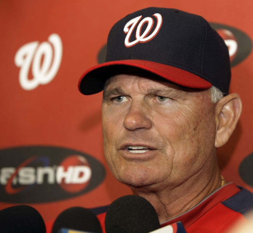 Washington Nationals interim manager John McLaren speaks during a news conference before an interleague baseball game between the Nationals and the Chicago White Sox, Friday, June 24, 2011, in Chicago.  (AP Photo/Nam Y. Huh)
