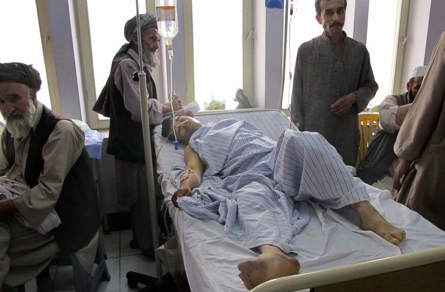 An injured Afghan man, a victim of a blast lies in a hospital bed in Kunduz city in the northern province of Kunduz, Afghanistan, Saturday, June 25, 2011. A bicycle rigged with explosives ripped through a bazaar in the Khanabad district of Kunduz province on Friday, killing at least 10 people, including a police officer. At least 24 people were wounded in the attack, according to an Interior Ministry statement. (AP Photo/Balal)