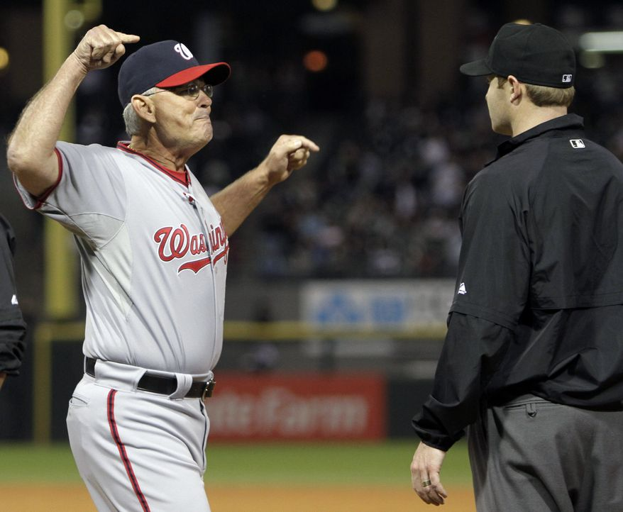 Washington Nationals interim manager John McLaren, left, argues with first base umpire Mike Estabrook during the eighth inning of an interleague baseball game against the Chicago White Sox in Chicago, Friday, June 24, 2011. (AP Photo/Nam Y. Huh)
