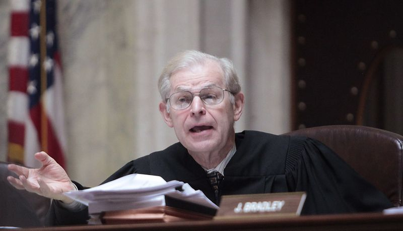 ** FILE ** Wisconsin Supreme Court Justice David Prosser poses a question during a hearing at the Capitol in Madison, Wis., on Monday, June 6, 2011. (AP Photo/John Hart, Pool)