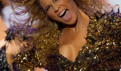 U.S singer Beyonce performs on the Pyramid stage at Glastonbury Music Festival, in Glastonbury, England, Sunday, June 26, 2011. More than 170,000 ticket-holders are at Worthy Farm for the 41st Glastonbury Music Festival. (AP Photo/Joel Ryan)