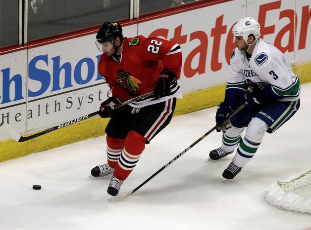 ASSOCIATED PRESS Troy Brouwer (left), acquired by Washington before the NHL draft Friday, played on all four lines in Chicago.