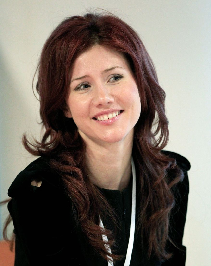 Anna Chapman, the red-haired agent with the lingerie-model looks, was betrayed by Col. Alexander Poteyev, a U.S. mole. (Associated Press)