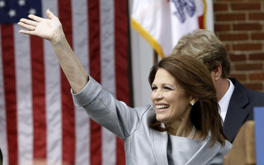Rep. Michele Bachmann, Minnesota Republican, waves to supporters before making her formal announcement to seek the 2012 Republican presidential nomination on June 27, 2011, in Waterloo, Iowa. (Associated Press)