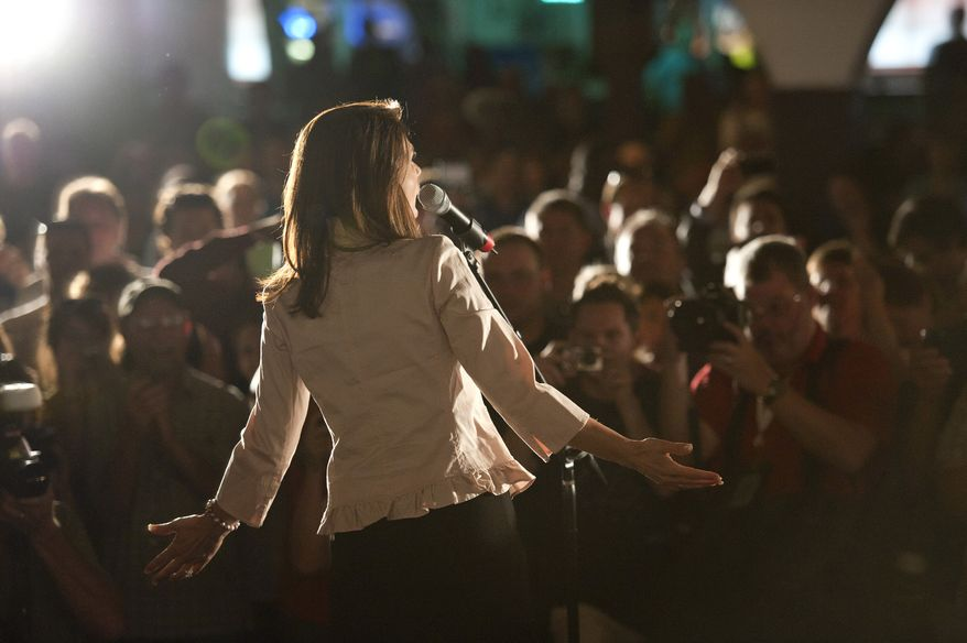 "Rep. Michele Bachmann, Minnesota Republican, greets supporters after a ""welcome home"" event in her hometown of Waterloo, Iowa, on June 26, 2011. (Associated Press/ The Star Tribune)"