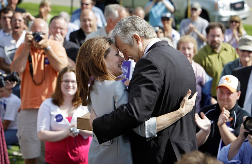 Rep. Michele Bachmann, R-Minn., gets a hug from her husband Marcus following her formal announcement to seek the 2012 Republican presidential nomination, Monday, June 27, 2011, in Waterloo, Iowa.   (AP Photo/Charlie Neibergall)