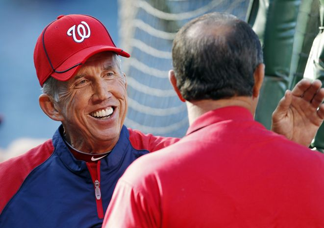 Washington Nationals manager Davey Johnson, left, talks with Clyde Wright during batting practice before an interleague baseball game against the Los Angeles Angels in Anaheim Calif., on Monday, June 27, 2011. It was announced yesterday that Johns