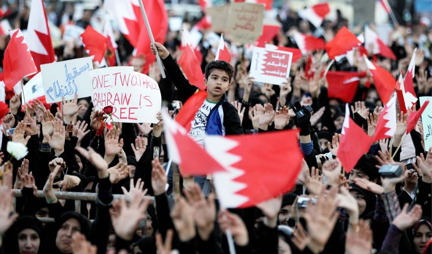 Bahraini anti-government protesters chant slogans in Manama, Bahrain in June, 2008. (Associated Press)