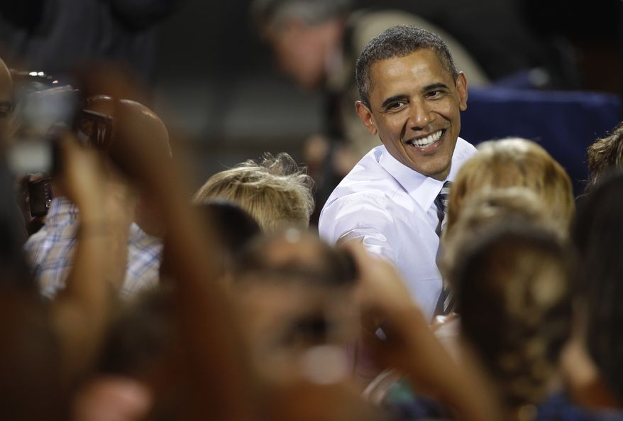 President Obama works the crowd after speaking at the Alcoa Davenport Works aluminum factory in Bettendorf, Iowa, on Tuesday, June 28, 2011. (AP Photo/Charlie Neibergall)