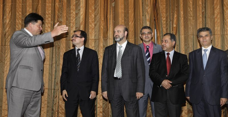 Mikhail Margelov (left), the Kremlin's Mideast envoy, welcomes a Syrian opposition delegation led by Washington-based rights activist Radwan Ziadeh (second from left) and Mulham Al-Droubi (third from left), one of the leaders of Syria's Muslim Brotherhood, prior to a meeting in Moscow on June 28, 2011. (Associated Press)