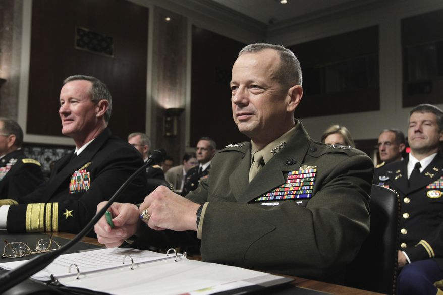 Marine Lt. Gen. John R. Allen (right), President Obama's choice to lead U.S. forces in Afghanistan, prepares to testify before the Senate Armed Services Committee at his nomination hearing on Capitol Hill in Washington on Tuesday, June 28, 2011. Navy Vice Adm. William H. McRaven, nominated as commander of the U.S. Special Operations Command, sits at left. (AP Photo/J. Scott Applewhite)