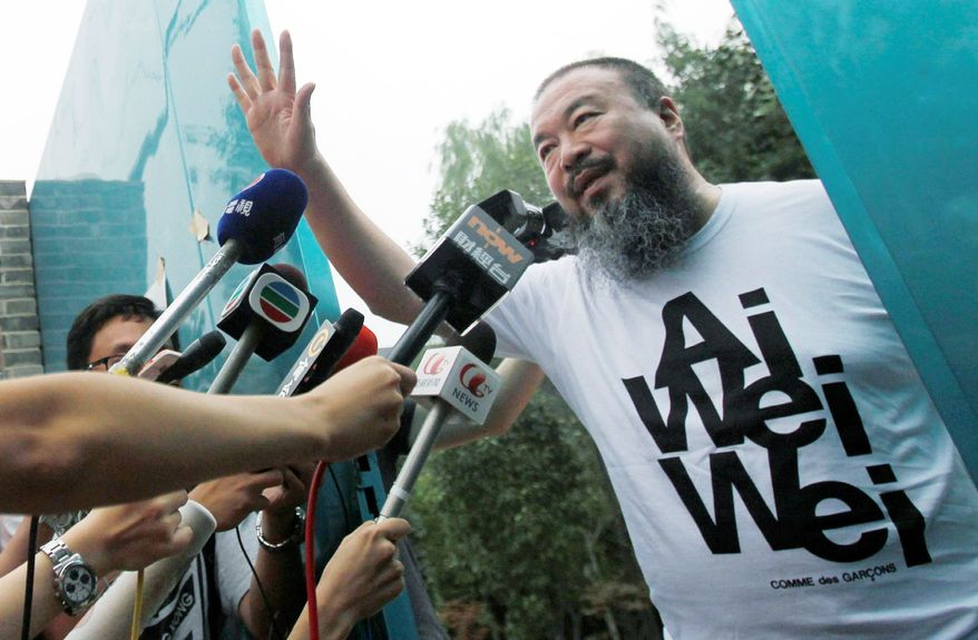 ASSOCIATED PRESS Activist and artist Ai Weiwei talks to journalists gathered outside his home in Beijing on June 23 after his release from government detention. He is challenging tax evasion charges and a $1.85 million tax bill. Chinese authorities previously have said Mr. Ai was released after he confessed to tax evasion and pledged to repay the money owed.