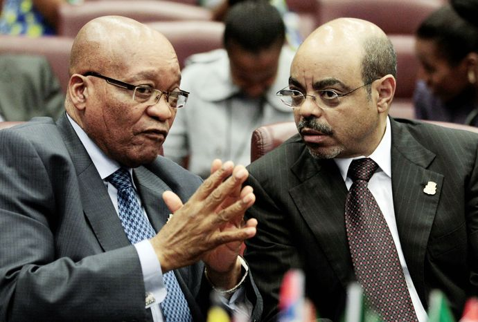 **FILE** South African President Jacob Zuma (left) and Ethiopian Prime Minister Meles Zenawi converse before a summit session.