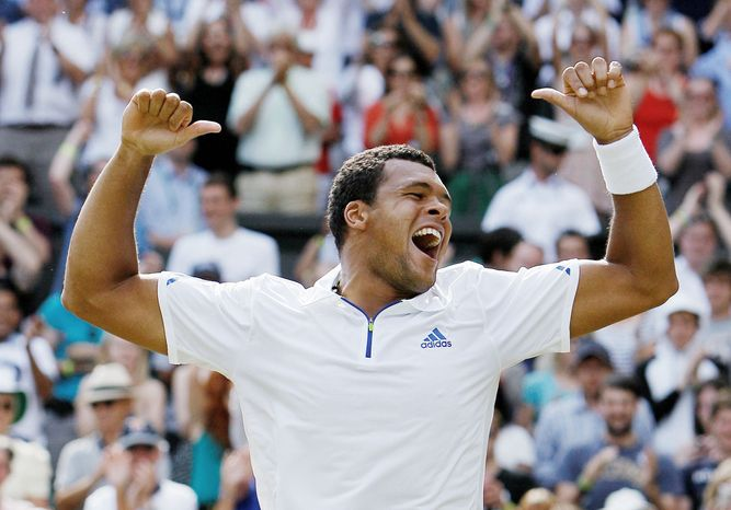 associated press photographs 12th-seeded Jo-Wilfried Tsonga celebrates after defeating Roger Federer. Tsonga will Novak Djokovic, who is 46-1 this season, in the semifinals Friday.