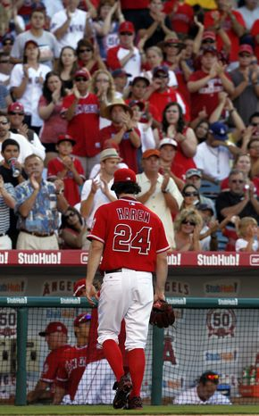 **FILE** Fans applaud for Los Angeles Angels pitcher Dan Haren (24) in the eighth inning as he leaves the game. The Angels won 1-0 and Haren allowed two hits in 7 1/3 innings and struck out six. (Associated Press)