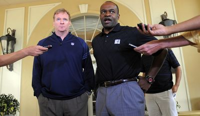 NFL commissioner Roger Goodell and National Football League Players Association executive director DeMaurice Smith speak to the media outside of the Ritz-Carlton hotel after addressing players during the NFLPA rookie symposium on Wednesday in Sarasota, Fla. (AP Photo/Brian Blanco)