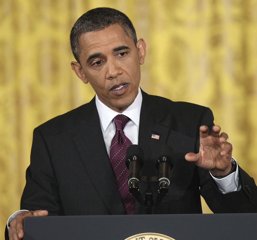 President Barack Obama gestures during a news conference in the East Room of the White House in Washington, Wednesday, June 29, 2011. (AP Photo/Carolyn Kaster)
