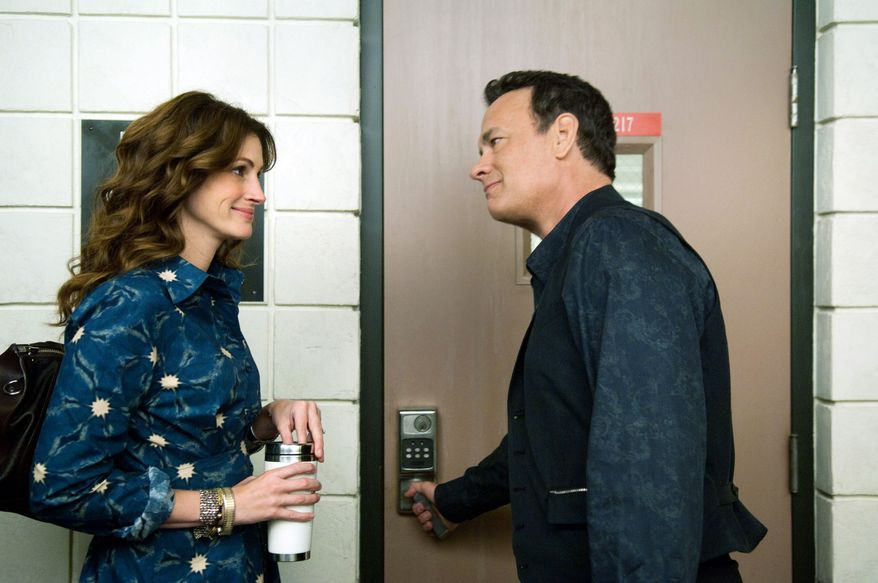 """ASSOCIATED PRESS After being laid off, Tom Hanks' character in """"Larry Crowne"""" enrolls in college where he meets a language arts professor played by Julia Roberts, who is dealing with her own troubles."""