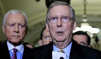 **FILE** Senate Minority Leader Mitch McConnell (right), Kentucky Republican, speaks to reporters on Capitol Hill in Washington on June 29, 2011, as Sen. Orrin G. Hatch, Utah Republican, looks on. (Associated Press)