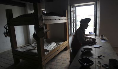 In a June 29, 2011, photo, interpreter Joseph Privott tells visitors about the life of a soldier in a barracks at Fort Ticonderoga in Ticonderoga, N.Y. (AP Photo/Mike Groll)