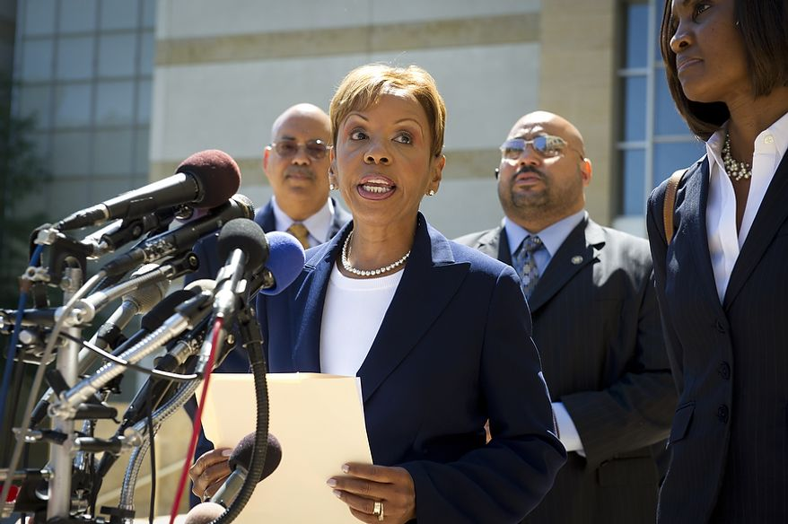 Prince George's County Councilwoman Leslie Johnson, 59, wife of former Prince George's County Executive Jack Johnson, stops to make a brief statement to reporters as she makes her exit after entering her plea of guilty to the charge of conspiring to obstruct a federal corruption investigation, at the U.S. District Court in Greenbelt, Md., Thursday, June 30, 2011. (Rod Lamkey Jr/The Washington Times)
