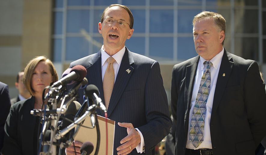 U.S. Attorney for the District of Maryland Rod J. Rosenstein (center) is flanked by Internal Revenue Service-Criminal Investigation Acting Special Agent in Charge, Jeannine A. Hammett (left) and FBI Special Agent in Charge Richard A. McFeely (right) as he makes a statement to reporters to announce that Prince George's County Councilwoman Leslie Johnson, 59, wife of former Prince George's County Executive Jack Johnson, pleaded guilty to the charge of conspiring to obstruct a federal corruption investigation, at the U.S. District Court in Greenbelt, Md., Thursday, June 30, 2011. (Rod Lamkey Jr/The Washington Times)