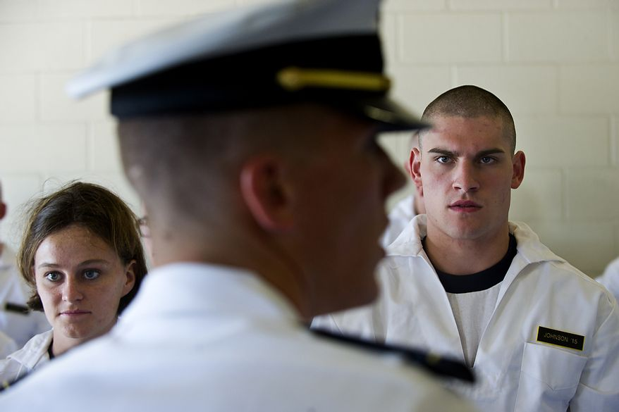 Midshipman 1/C Ken Bunnell (foreground) gives instructions to plebes (from left) Anna Funkhouser and Michael Johnson during Induction Day at the U.S. Naval Academy in Annapolis on Thursday, June 30, 2011. (Drew Angerer/The Washington Times)
